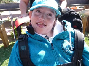Boy with disabilities in blue sweat and cap